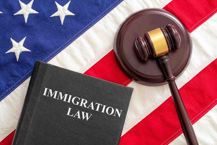 judge gavel and immigration law book on united sta
